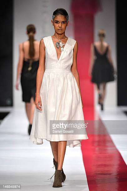 Model showcases designs by Monster Alphabets on the catwalk during StyleAID 2012 at the Burswood Entertainment Complex on July 27, 2012 in Perth,...