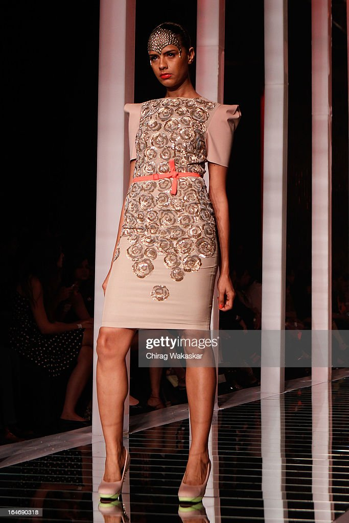 A model showcases designs by Namrata Joshipura on the runway during day five of Lakme Fashion Week Summer/Resort 2013 on March 26, 2013 at Grand Hyatt in Mumbai, India.
