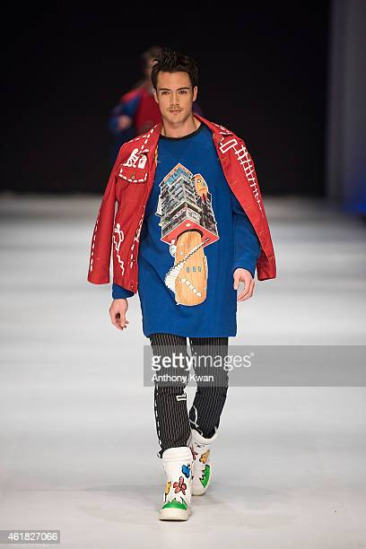 Model showcases designs by Nelson Leung on the runway during the Hong Kong Young Fashion Designers Contest 2015 on day 2 of Hong Kong Fashion Week...