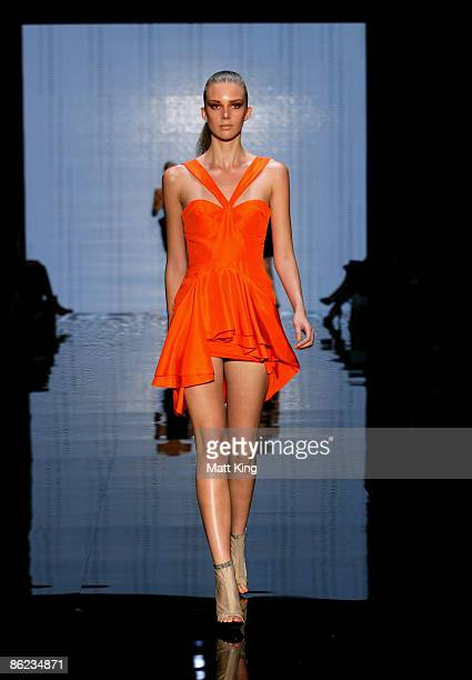 Model showcases designs by Nicola Finetti on the catwalk at the Overseas Passenger Terminal, Circular Quay on day one of Rosemount Australian Fashion...