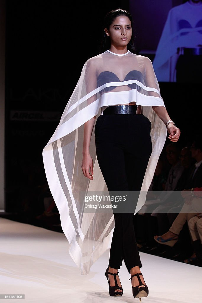 A model showcases designs by Nikhil Thampi on the runway during day two of the Lakme Fashion Week Summer/Resort 2013 on March 23, 2013 at Grand Hyatt in Mumbai, India.