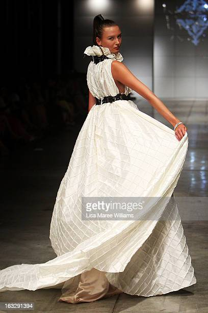 A model showcases designs by Niki Teljega on the runway during Fashion Palette 2013 on March 7 2013 in Sydney Australia