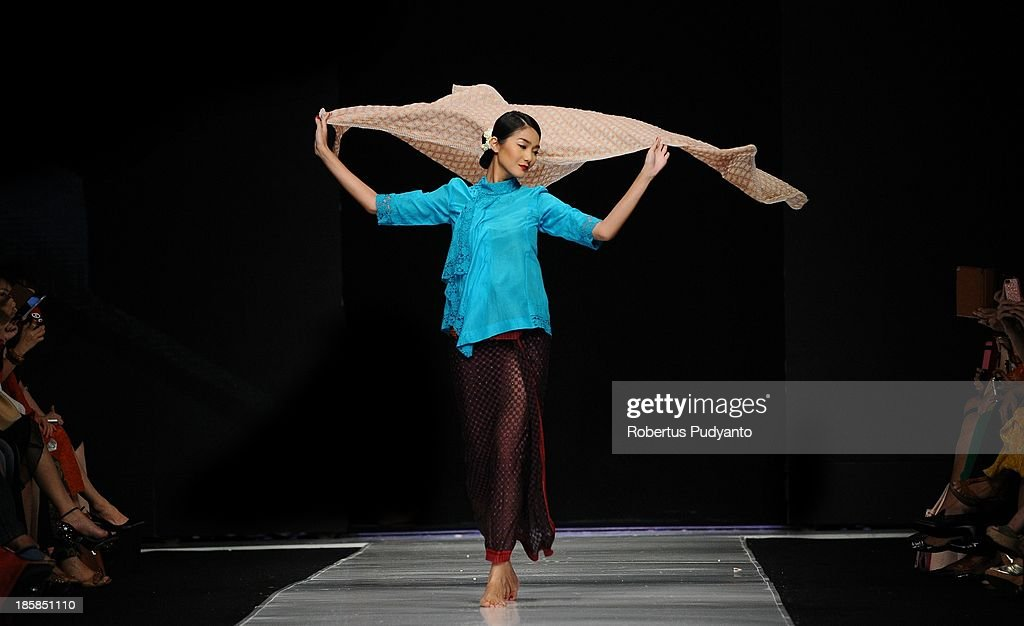 A model showcases designs by Obin on the runway at the Indonesia Memanggil show during Jakarta Fashion Week 2014 at Senayan City on October 25, 2013 in Jakarta, Indonesia.