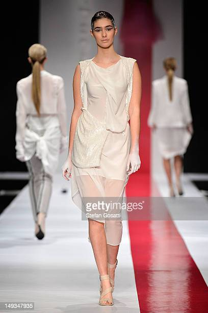 Model showcases designs by One Fell Swoop on the catwalk during StyleAID 2012 at the Burswood Entertainment Complex on July 27, 2012 in Perth,...