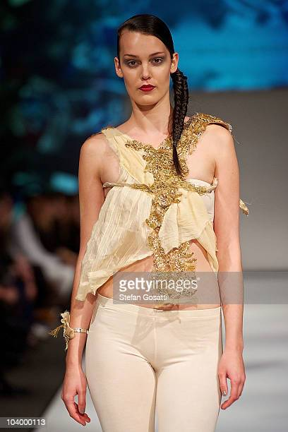 Model showcases designs by Pinchandspoon during the WA Designers Collection 2 catwalk show as part of Perth Fashion Week 2010 at Fashion Paramount on...