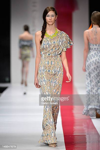Model showcases designs by Poppy Lissiman on the catwalk during StyleAID 2012 at the Burswood Entertainment Complex on July 27, 2012 in Perth,...