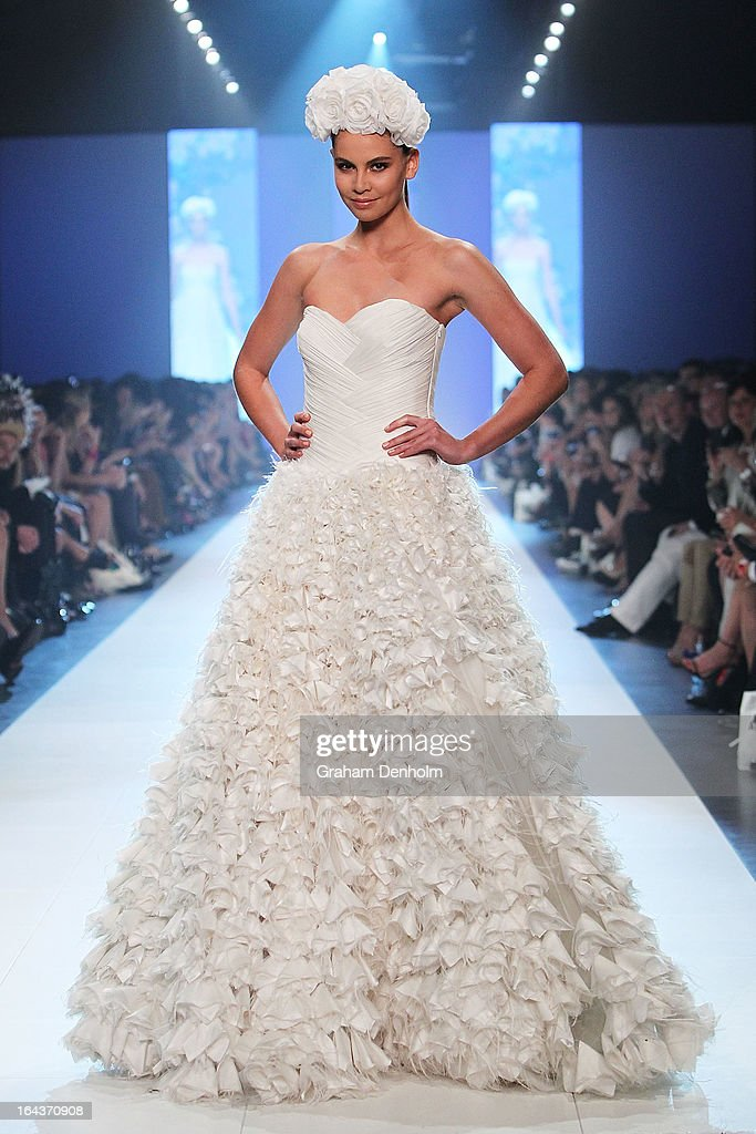 A model showcases designs by Rachel Gilbert on the runway at the Red Carpet Runway show during day six of L'Oreal Melbourne Fashion Festival on March 23, 2013 in Melbourne, Australia.