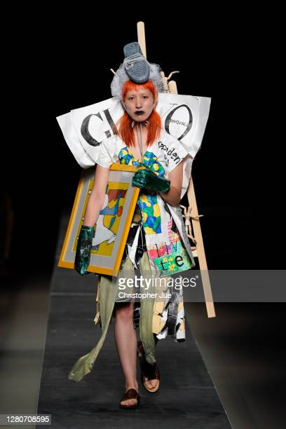 Model showcases designs by RequaL≡ on the runway during Rakuten Fashion Week TOKYO 2021 Spring/Summer on October 17, 2020 in Tokyo, Japan.