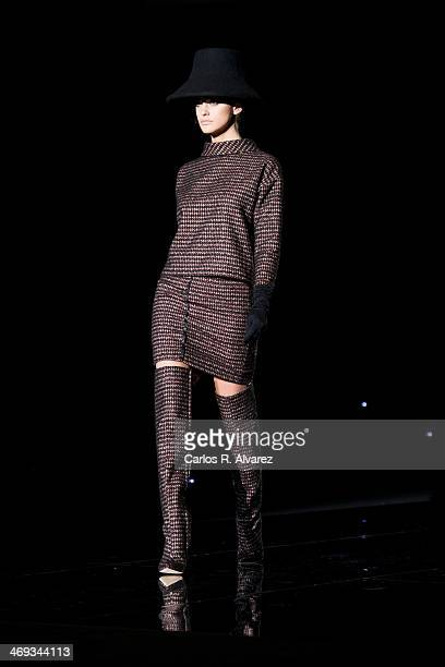 A model showcases designs by Roberto Verino on the runway at Roberto Verino show during Mercedes Benz Fashion Week Madrid Fall/Winter 2014 at Ifema...