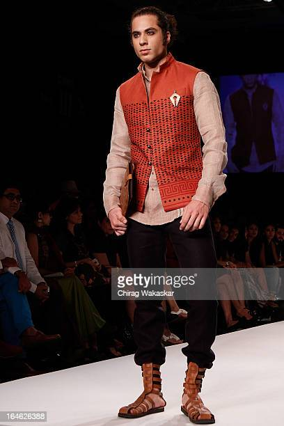 A model showcases designs by Rohit Abhishek on the runway during day four of Lakme Fashion Week Summer/Resort 2013 on March 25 2013 at Grand Hyatt in...