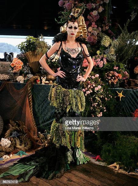 A model showcases designs by Romance Was Born on the catwalk offsite at The Wharf Restaurant at the Sydney Theatre Company on day four of Rosemount...