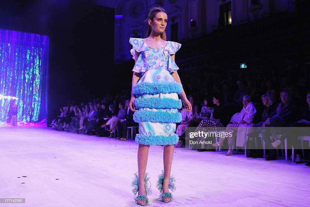 A model showcases designs by Romance Was Born on the runway at the MBFWA Trends show during Mercedes-Benz Fashion Festival Sydney 2013 at Sydney Town Hall on August 21, 2013 in Sydney, Australia.