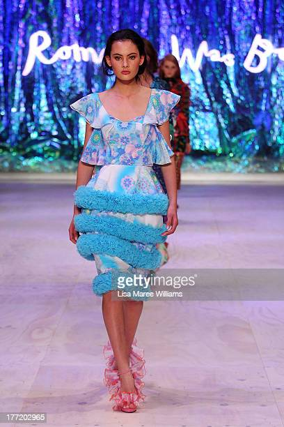 A model showcases designs by Romance Was Born on the runway at the InStyle Red Carpet Runway show during MercedesBenz Fashion Festival Sydney 2013 at...
