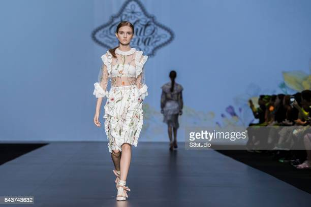 A model showcases designs by Salut ca va on the runway during the Designers' Collection Show 2 MACAO FASHION PARADE on the Day 2 of the CentreStage...