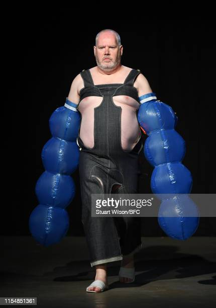 A model showcases designs by San Kim on the runway at the University of Westminster MA Menswear show during London Fashion Week Men's June 2019 at...