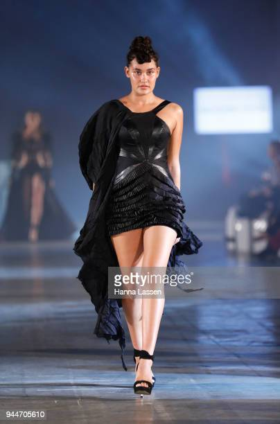 A model showcases designs by Sarah Joseph Couture during the Jurassic World Fallen Kingdom Runway Show on April 11 2018 in Sydney Australia