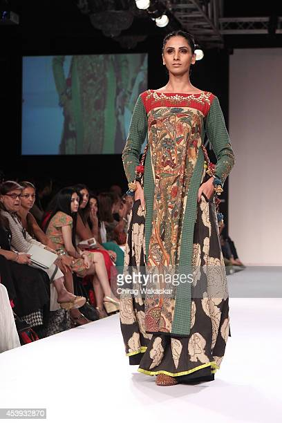 A model showcases designs by Sashikant Naidu during day 2 of Lakme Fashion Week Winter/Festive 2014 at The Palladium Hotel on August 21 2014 in...