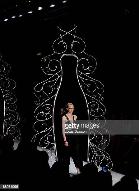 Model showcases designs by Sass & Bide at the Diet Coca-Cola Little Black Dress Show on the catwalk at the Overseas Passenger Terminal, Circular Quay...