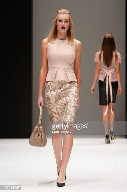 A model showcases designs by Scanlan Theodore on the catwalk on day 2 of Melbourne Spring Fashion Week 2012 at Melbourne Town Hall on September 4...