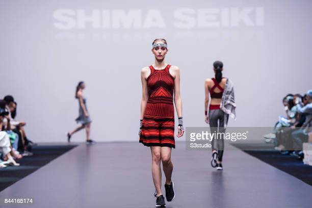 A model showcases designs by Shima Seiki during the Knitwear Symphony 2017 The 7th Hong Kong Young Knitwear Designers' Contest at Hong Kong...