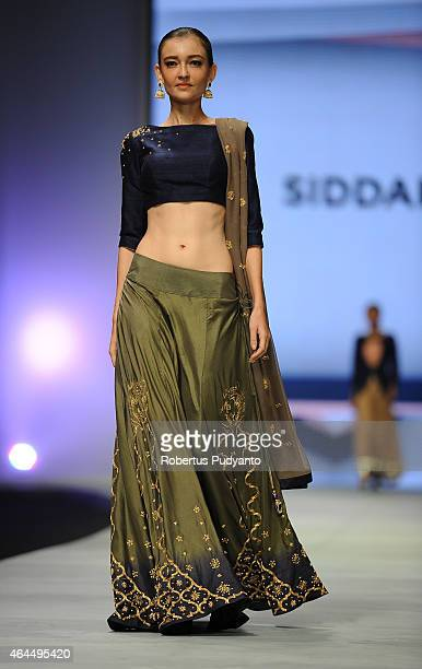 A model showcases designs by Siddart Shasankan of India on the runway in the Aggrandize show during Indonesia Fashion Week 2015 at Jakarta Convention...