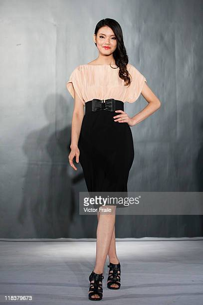 A model showcases designs by Sinosky on the catwalk during day four of Hong Kong Fashion Week Spring/Summer 2011/12 at the Hong Kong Convention and...