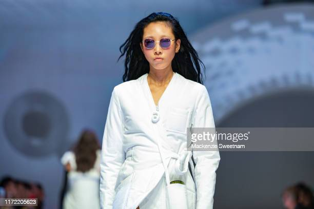 A model showcases designs by Slow Waves during Town Hall Runway 5 at Melbourne Town Hall at Melbourne City Baths on September 04 2019 in Melbourne...