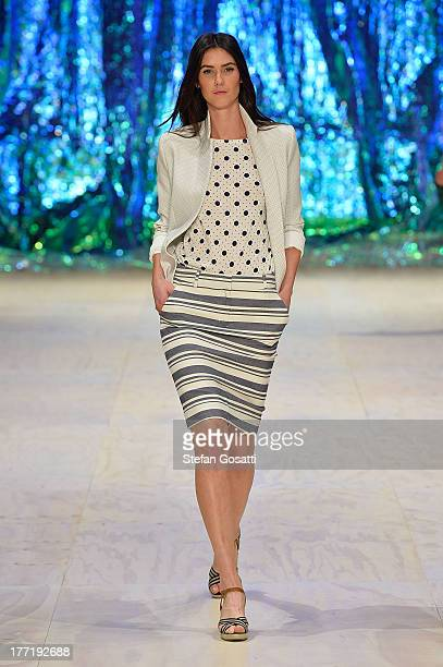 A model showcases designs by Sportscraft on the runway at the Sportscraft show during MercedesBenz Fashion Festival Sydney 2013 at Sydney Town Hall...