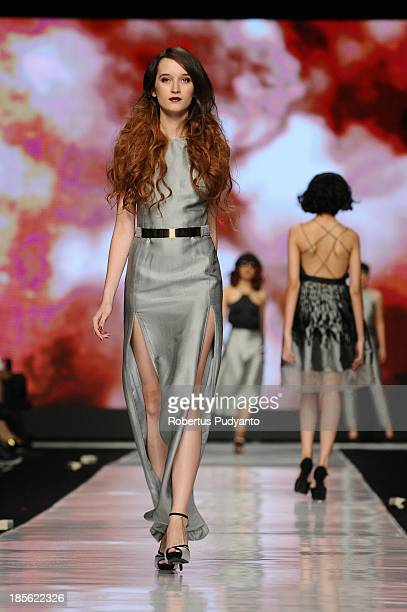 A model showcases designs by Stella Rissa and hair by Andi Lie on the runway at the It Looks Fall Winter 13/14 show during Jakarta Fashion Week 2014...