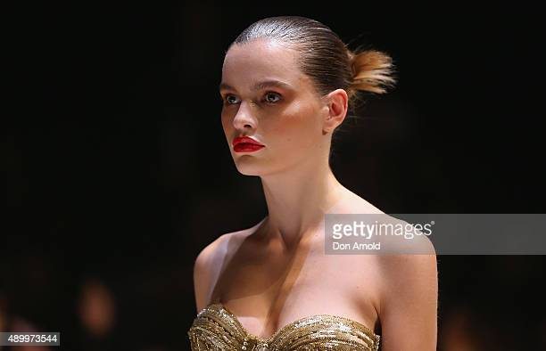 A model showcases designs by Steven Khalil during the Red Carpet show at MercedesBenz Fashion Festival Sydney 2015 at Sydney Town Hall on September...