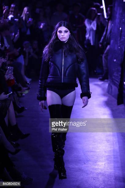 A model showcases designs by Stolen Girlfriends Club on the runway at New Zealand Fashion Week 2017 on August 30 2017 in Auckland New Zealand