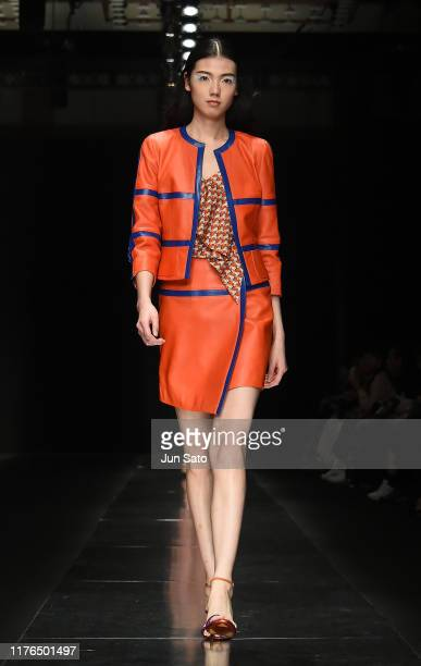 A model showcases designs by Tae Ashida on runway during the Rakuten Fashion Week Tokyo 2020 S/S on October 18 2019 in Tokyo Japan