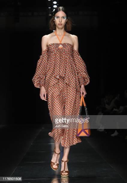 Model showcases designs by Tae Ashida on runway during the Rakuten Fashion Week Tokyo 2020 S/S on October 18, 2019 in Tokyo, Japan.
