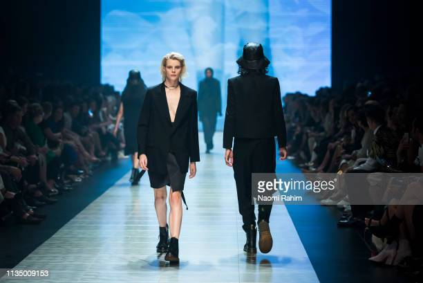 A model showcases designs by Ten Pieces at Melbourne Fashion Festival on March 9 2019 in Melbourne Australia