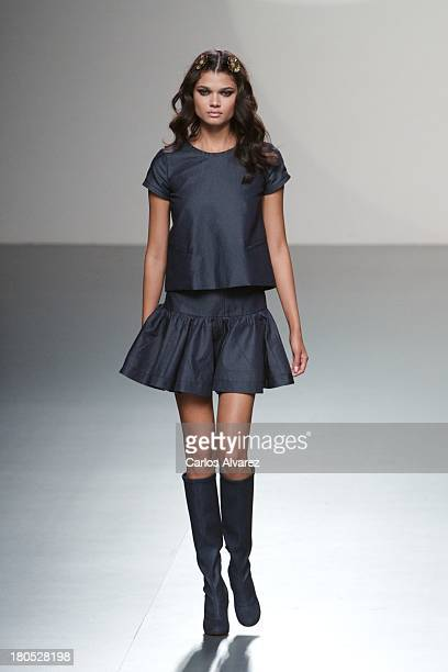 A model showcases designs by Teresa Helbig on the runway at Teresa Helbig show during Mercedes Benz Fashion Week Madrid Spring/Summer 2014 on...