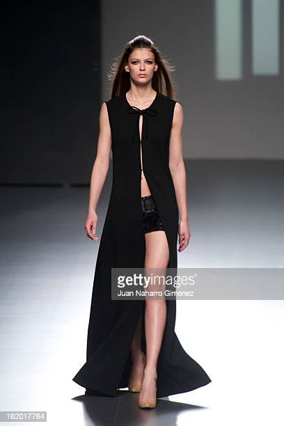 A model showcases designs by Teresa Helbig on the runway at the Teresa Helbig show during Mercedes Benz Fashion Week Madrid Fall/Winter 2013/14 at...