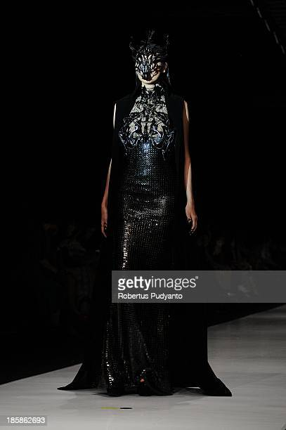A model showcases designs by Tex Saverio on the runway at the Prive show during Jakarta Fashion Week 2014 at Senayan City on October 25 2013 in...