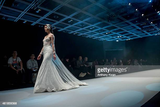 A model showcases designs by the Angela Chung on the runway during the Brand Collection Show on day 3 of Hong Kong Fashion Week Fall/Winter 2015 at...