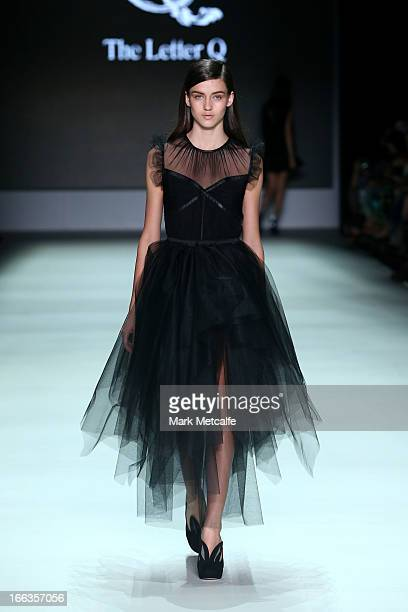 A model showcases designs by The Letter Q on the runway at the New Generation show during MercedesBenz Fashion Week Australia Spring/Summer 2013/14...
