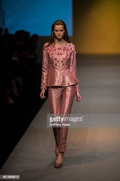 A model showcases designs by the Meggie Hadiyanto on the runway during the Brand Collection Show on day 3 of Hong Kong Fashion Week Fall/Winter 2015...
