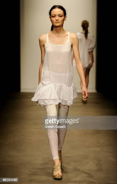 Model showcases designs by Therese Rawsthorne on the catwalk at the Overseas Passenger Terminal, Circular Quay on day one of Rosemount Australian...