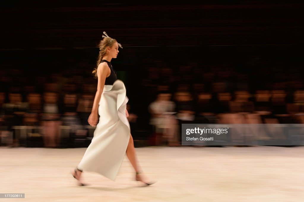 A model showcases designs by Toni Maticevski on the runway at the InStyle Red Carpet Runway show during Mercedes-Benz Fashion Festival Sydney 2013 at Sydney Town Hall on August 22, 2013 in Sydney, Australia.