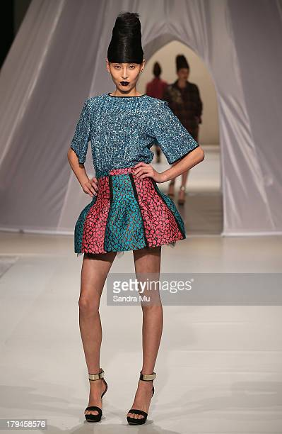 A model showcases designs by Trelise Cooper on the runway during New Zealand Fashion Week at the Viaduct Events Centre on September 4 2013 in...