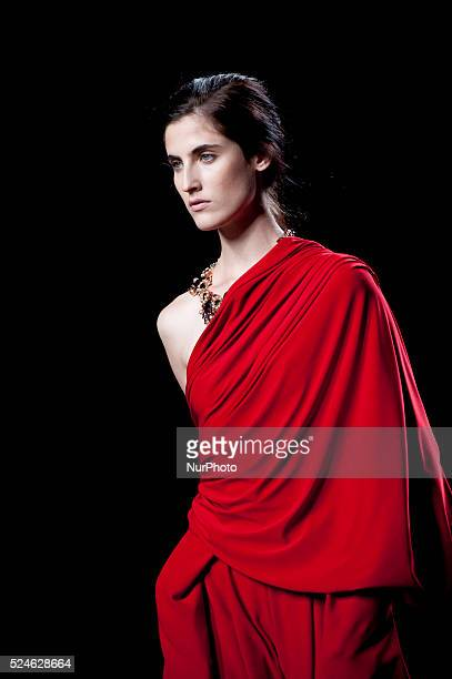 Model showcases designs by Ulies Merida on the runway at Ulises Merida show during Mercedes Benz Fashion Week Madrid Spring/Summer 2015 at Ifema on...