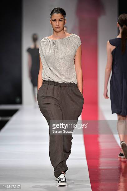 A model showcases designs by United Constructions on the catwalk during StyleAID 2012 at the Burswood Entertainment Complex on July 27 2012 in Perth...