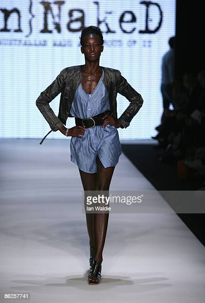 A model showcases designs by {Un}NakeD as part of the Men's and Women's Ready To Wear catwalk show at the Overseas Passenger Terminal Circular Quay...