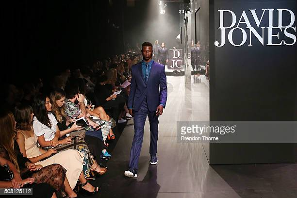 A model showcases designs by Versace on the runway at the David Jones Autumn/Winter 2016 Fashion Launch at David Jones Elizabeth Street Store on...