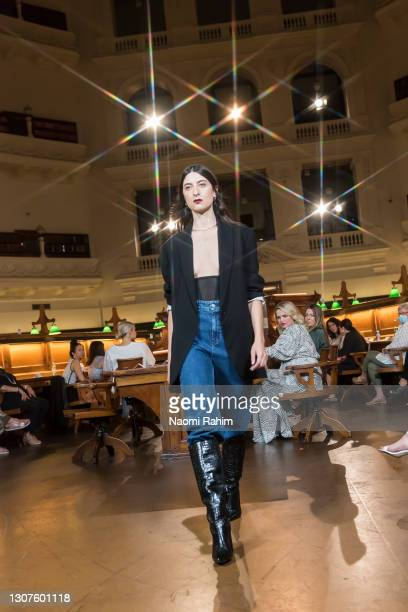 Model showcases designs by Viktoria & Woods during Runway 4 at Melbourne Fashion Festival at the State Library of Victoria on March 17, 2021 in...