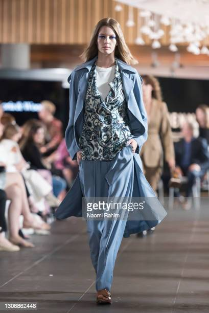 Model showcases designs by Viktoria & Woods during the Gala Runway at Melbourne Fashion Festival at National Gallery of Victoria on March 11, 2021 in...
