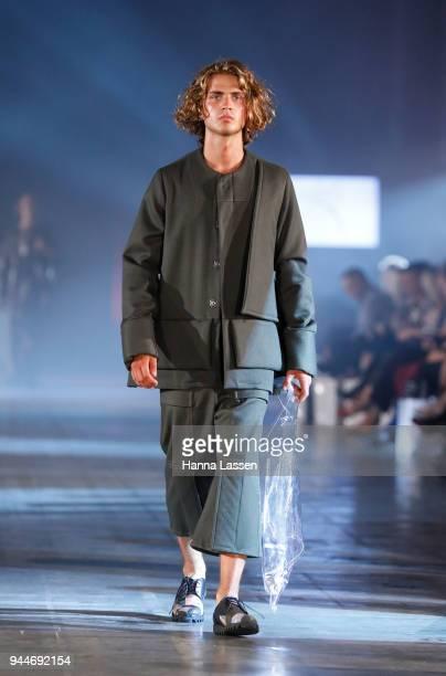 A model showcases designs by Vincent Li during the Jurassic World Fallen Kingdom Runway Show on April 11 2018 in Sydney Australia